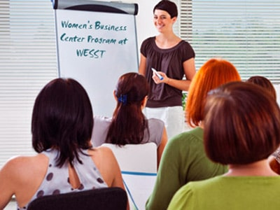 woman teaching with a whiteboard